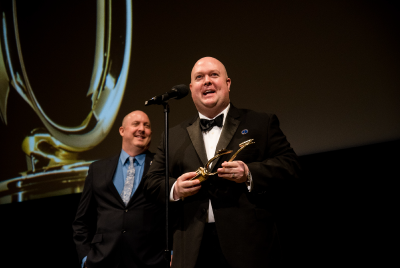 J. Michael Collins and A.J. McKay on stage at voice arts award ceremony